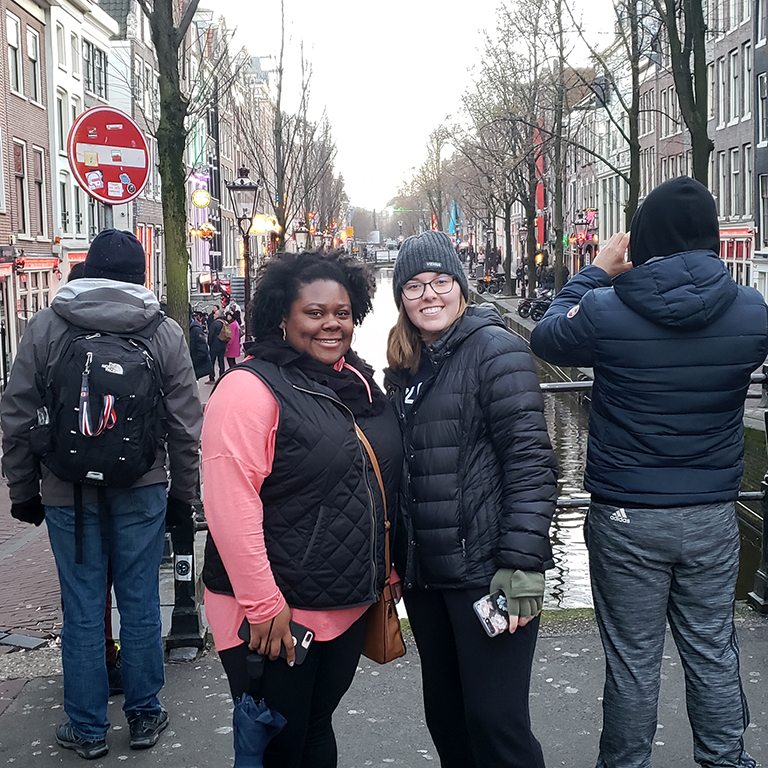 Erica Washington standing above a canal in Amsterdam